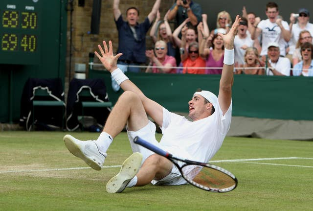 Isner celebrates his famous victory after finally breaking Mahut's serve in the fifth set - two days after they started the match
