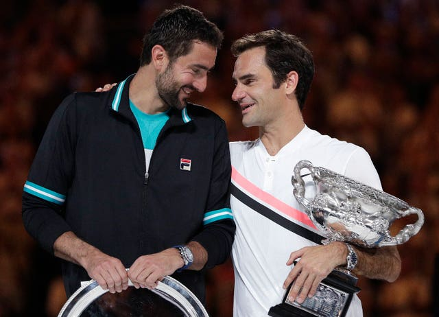 Roger Federer and Marin Cilic share a moment during the trophy ceremony