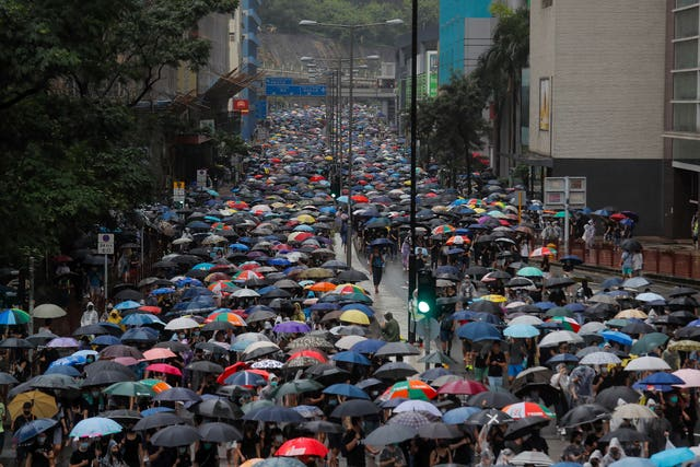 Umbrella-carrying protesters took to the streets earlier in the day