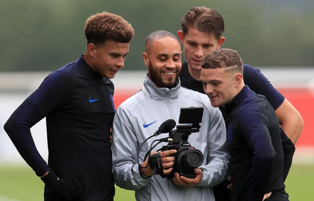 Trippier (right) has not been shy about rewatching his moment in the spotlight.