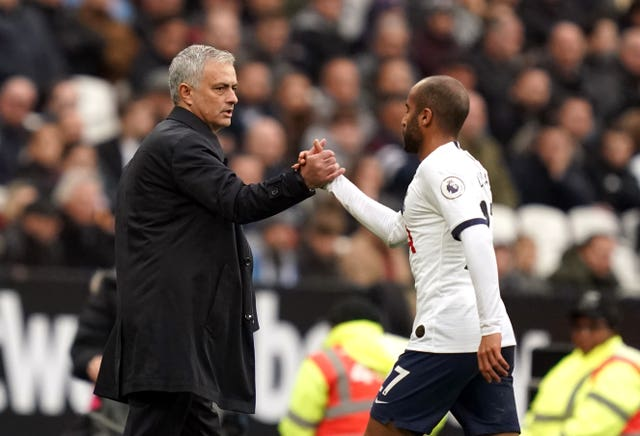 Mourinho (left) shakes hands with Moura as he is substituted at West Ham