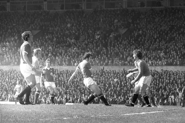 Denis Law (second left), formerly of Manchester United, puts the seal on his old club's relegation with a back-flicked goal for Manchester City in the match at Old Trafford