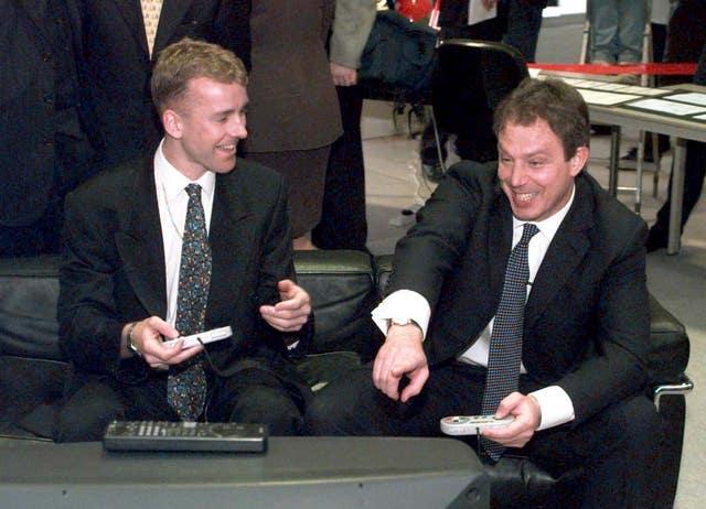 Tony Blair playing a computer football game (Sean Dempsey/PA)