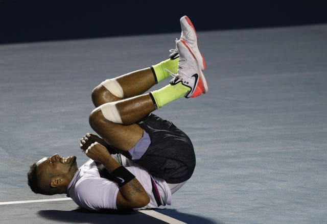 Kyrgios falls to the court in celebration of his victory