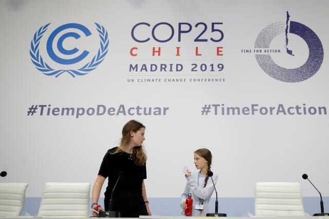 Miss Thunberg, right, and Luisa Neubauer arrive for a news conference at the COP25 Climate summit in Madrid