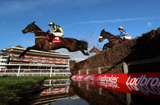Willoughby Court and Nico de Boinville clear the water jump before going on to victory at Newbury