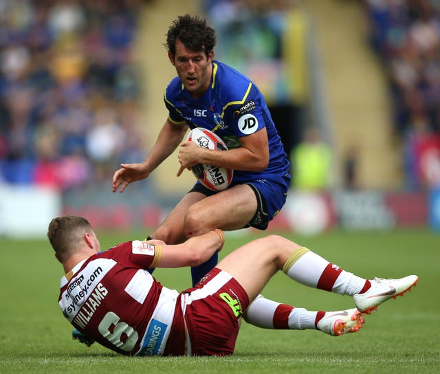 Stefan Ratchford, right, takes on Wigan's George Williams
