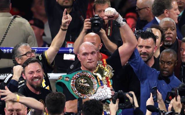 Tyson Fury celebrates with the WBC heavyweight belt after defeating Deontay Wilder