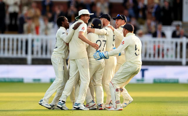 Joe Denly, centre, was mobbed after his fine catch accounted for Australia captain Tim Paine as England pushed for victory on day five