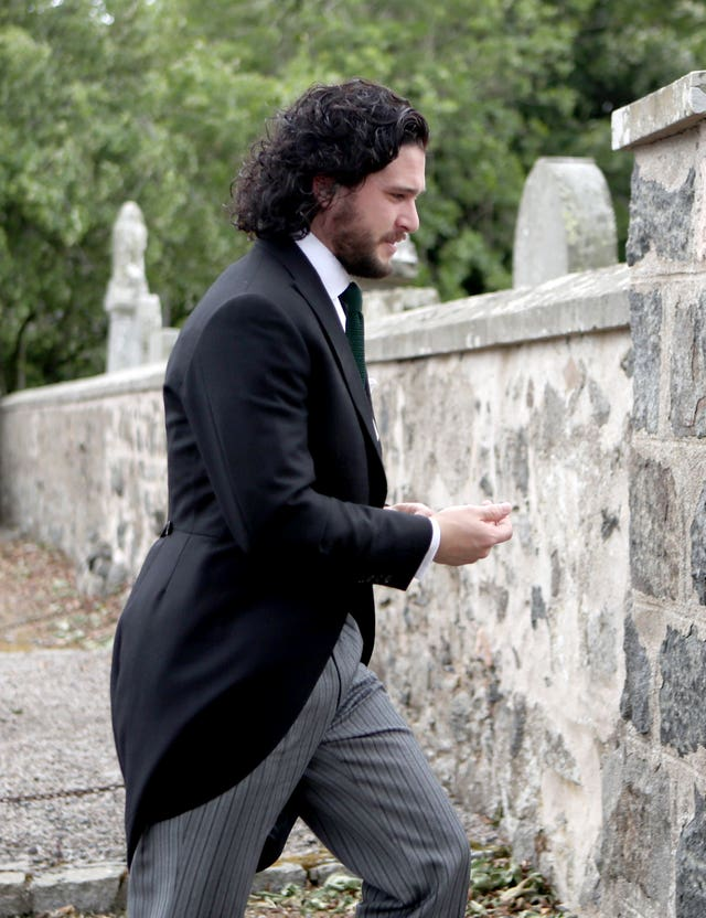 Groom Kit Harington in his wedding suit