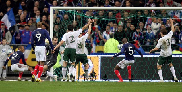 France's William Gallas (second right) heads home Thierry Henry's cross