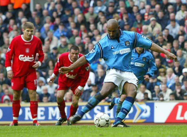 Nicolas Anelka, right, scores a penalty in City's most recent win at Anfield