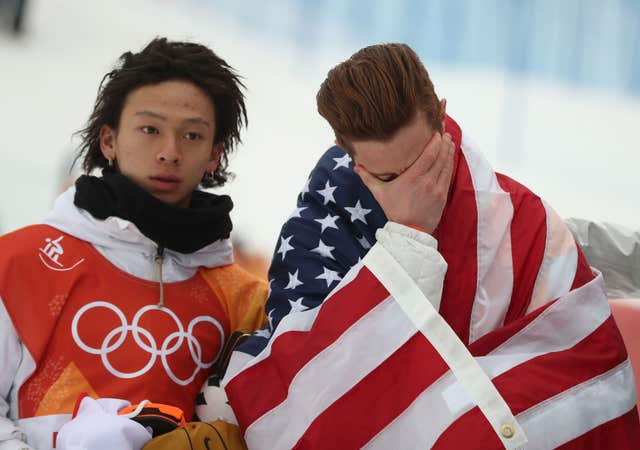USA's Shaun White gets emotional after claiming an historic third Olympic halfpipe gold