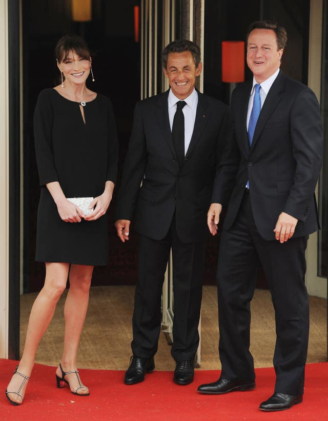 French President Nicolas Sarkozy and his wife Carla Bruni with former British Prime Minister David Cameron