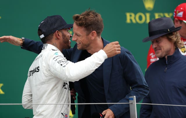 Lewis Hamilton is congratulated at the 2017 British Grand Prix by Jenson Button