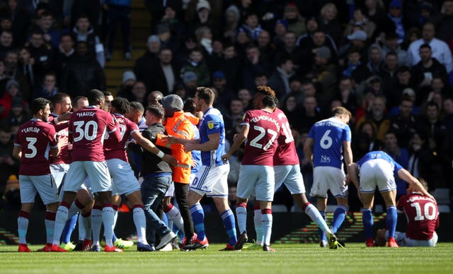 Birmingham supporter Paul Mitchell was led away after attacking Aston Villa's Jack Grealish on the pitch (right). (Nick Potts/PA)