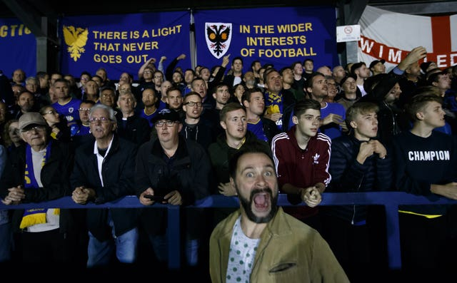 AFC Wimbledon's fans before the start of a game against MK Dons