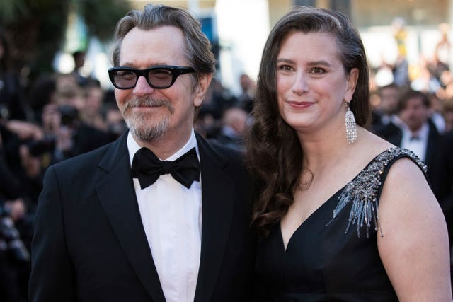 Actor Gary Oldman and wife Gisele Schmidt pose for photographers on the red carpet at the Cannes Film Festival (Photo by Vianney Le Caer/Invision/AP)