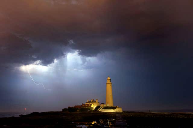 St Mary's Lighthouse near Whitley Bay with a lightning strom in the background