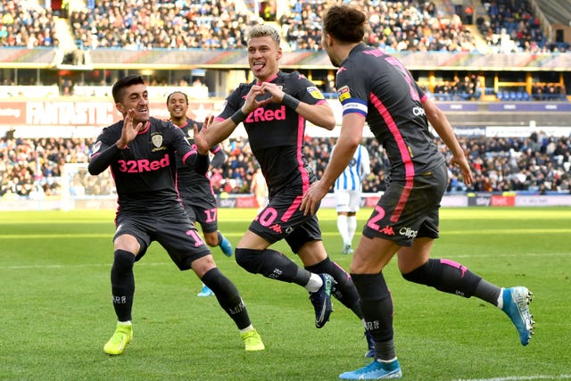 Leeds' Ezgjan Alioski scored as the Whites won their West Yorkshire derby 2-0 against Huddersfield