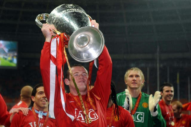 Rooney celebrates with the Champions League trophy