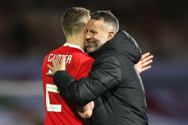 Chris Gunter, left, embraces Ryan Giggs