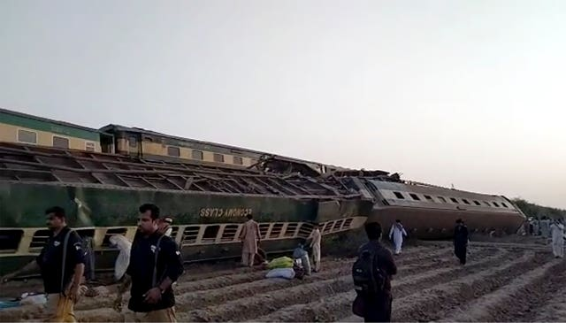 This image from a video shows a train after a collision in Ghotki, Pakistan