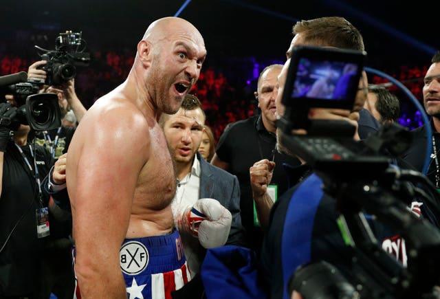 Tyson Fury celebrates his win over Tom Schwarz