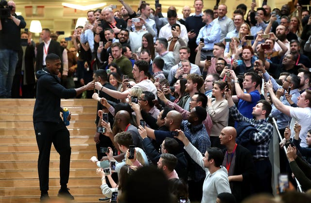 Anthony Joshua greets fans as he arrives at the final press conference