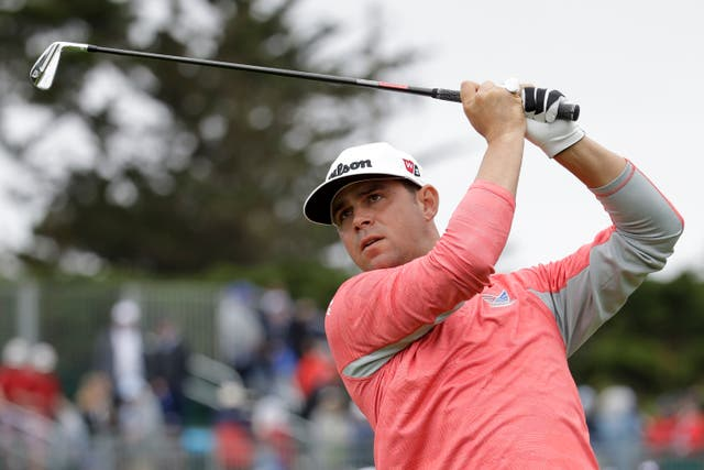 Overnight leader Gary Woodland moved two shots clear at Pebble Beach