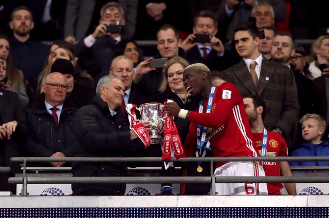 Mourinho and Paul Pogba with the trophy after the EFL Cup Final at Wembley in February 2017