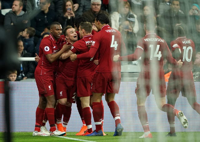 Liverpool players celebrate after Divock Origi's winner