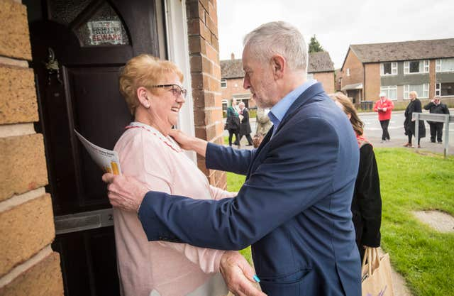 Labour leader Jeremy Corbyn is greeted by Catherine Finney while on the campaign trail in Lancashire