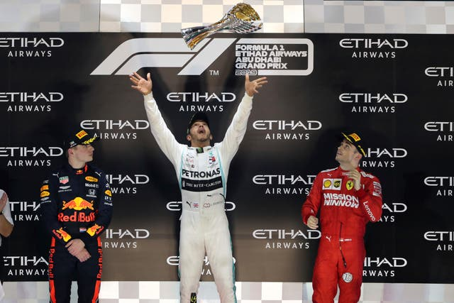 World champion Lewis Hamilton, centre, won the season-ending Abu Dhabi Grand Prix