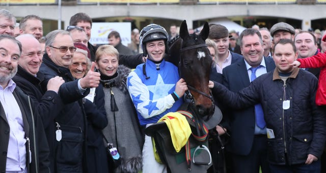 Kemboy with David Mullins and members of the Supreme Horse Racing Club