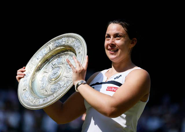 Marion Bartoli celebrates winning the Wimbledon title in 2013