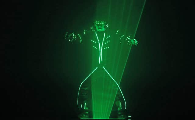 A performer from the Duo Lugo Laser act (Niall Carson/PA)
