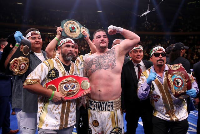 Joshua has vowed to win back the belts he lost to Andy Ruiz Jr (centre)
