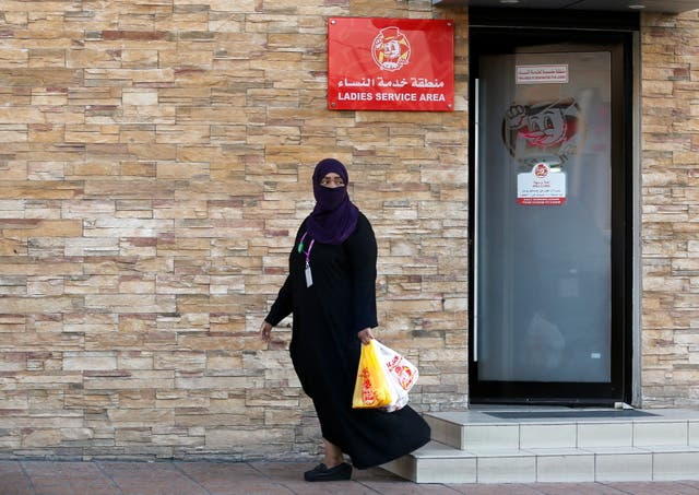 A woman leaves a ladies only service area at a restaurant in Jiddah