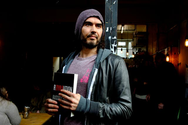 Russell Brand opens the Trew Era Cafe – London