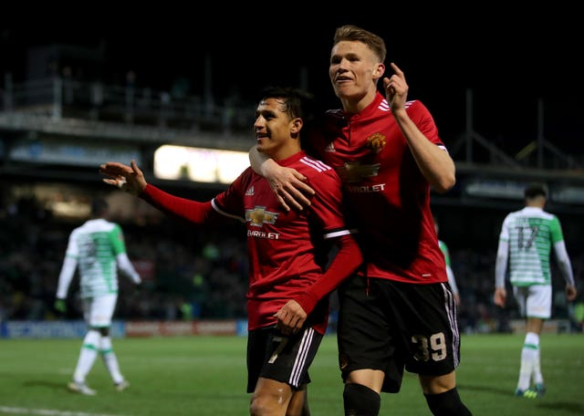 Alexis Sanchez (left) celebrates with Scott McTominay (right) after Ander Herrera scored Manchester United's second goal against Yeovil