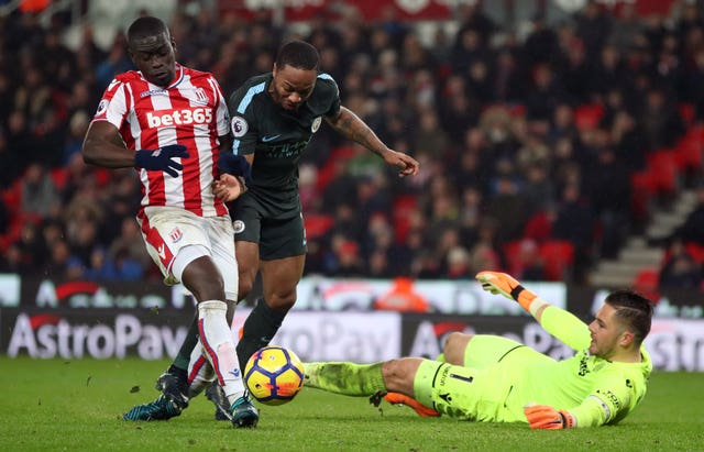 Jack Butland looks to prevent Raheem Sterling from scoring