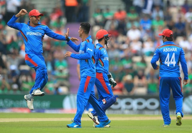 Mujeeb Ur Rahman, centre, had earlier taken three wickets for Afghanistan (Adam Davy/PA)