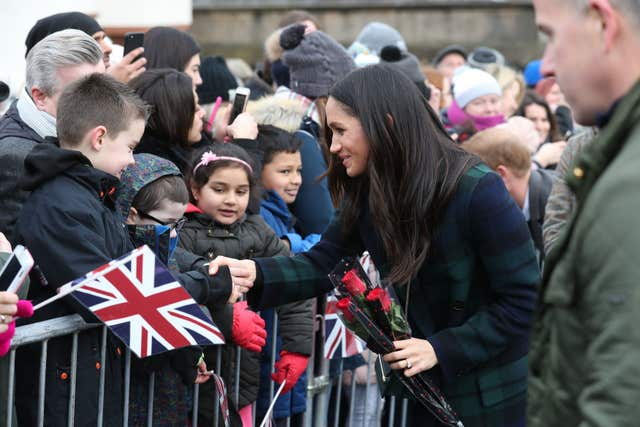 Meghan Markle meets young well-wishers who braved the cold to see her in Edinburgh (Andrew Milligan/PA)