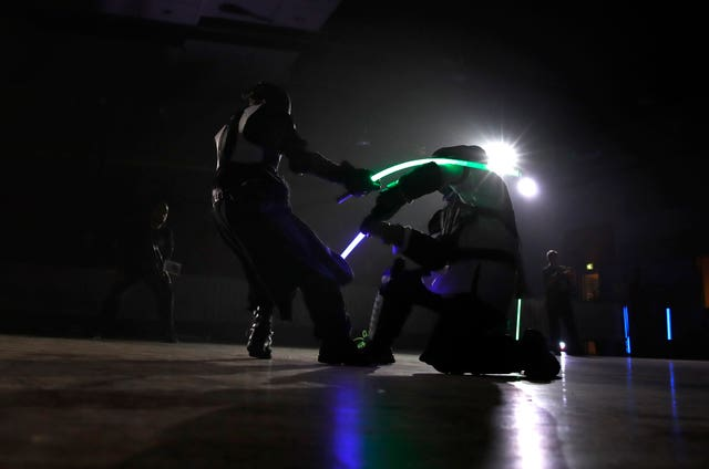 Competitors battle during a national lightsabre tournament in Beaumont-sur-Oise, north of Paris