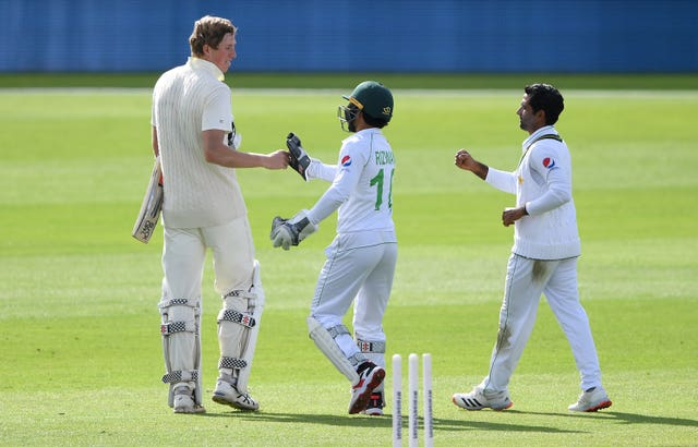 Crawley (left) bumps fists with Pakistan's Mohammed Rizwan