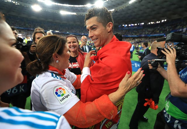 Real Madrid's Cristiano Ronaldo celebrates with his mother Dolores after winning the UEFA Champions League  final in Kiev