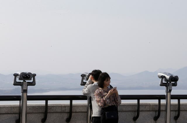 A man watches the North side from the unification observatory in Paju, South Korea (Ahn Young-joon/AP)