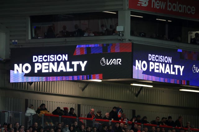 The VAR screen shows a 'No Penalty' decision at Anfield