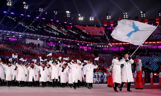 North Korea's Hwang Chung Gum and South Korea's Won Yun-jong carry the unification flag during the opening ceremony of the 2018 Winter Olympics (Jae C. Hong/AP)